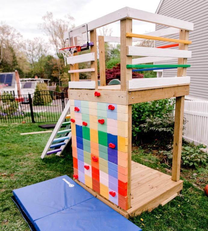 diy backyard playground with climbing wall for homeschool recess